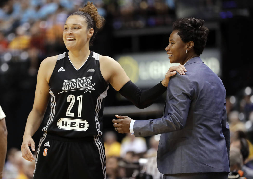 FILE - In this July 12, 2017, file photo, San Antonio Stars' Kayla McBride laughs with head coach Vickie Johnson during the second half of a WNBA basketball game against the Indiana Fever, in Indi ...