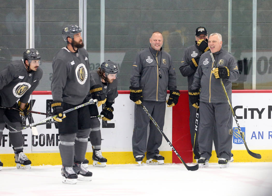 Golden Knights head coach Gerard Gallant, left, and first assistant coach Mike Kelly watch their players during team practice at City Center Arena on Wednesday, May 23, 2018, in Las Vegas. Bizuaye ...