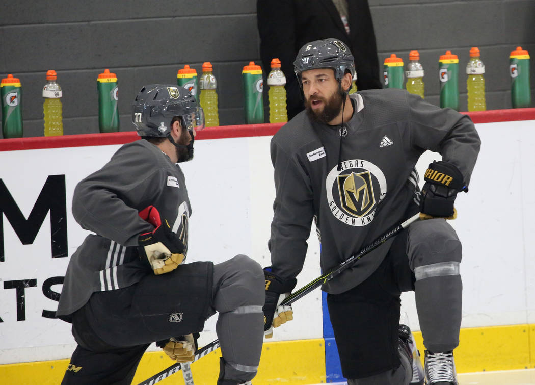 Golden Knights defensemen Brad Hunt, left, and Deryk Engelland chat during team practice at City Center Arena on Wednesday, May 23, 2018, in Las Vegas. Bizuayehu Tesfaye/Las Vegas Review-Journal @ ...