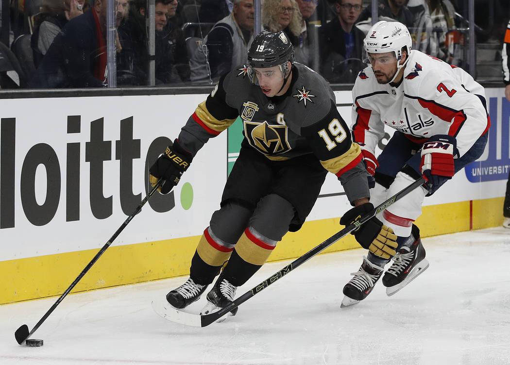 Vegas Golden Knights right wing Reilly Smith (19) skates around Washington Capitals defenseman Matt Niskanen (2) during the first period of an NHL hockey game Saturday, Dec. 23, 2017, in Las Vegas ...