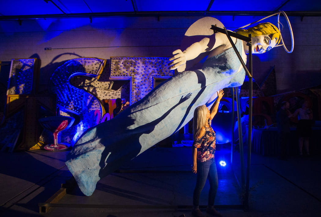 Artist Nancy Good poses for a photo with the Blue Angel statue, designed by Betty Willis, at the Neon Museum's Ne10 Studio in Las Vegas on Thursday, May 24, 2018. The statue came down from its per ...