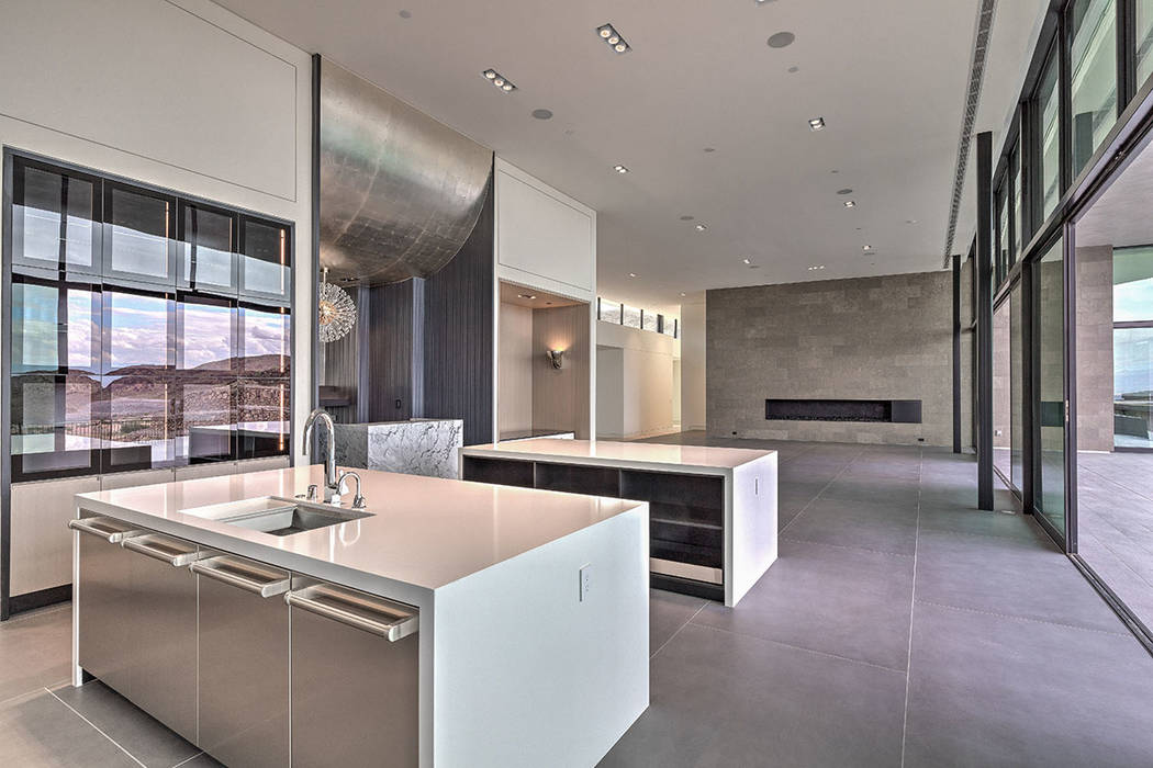 The kitchen leads into the family room. (Hoogland Architecture)