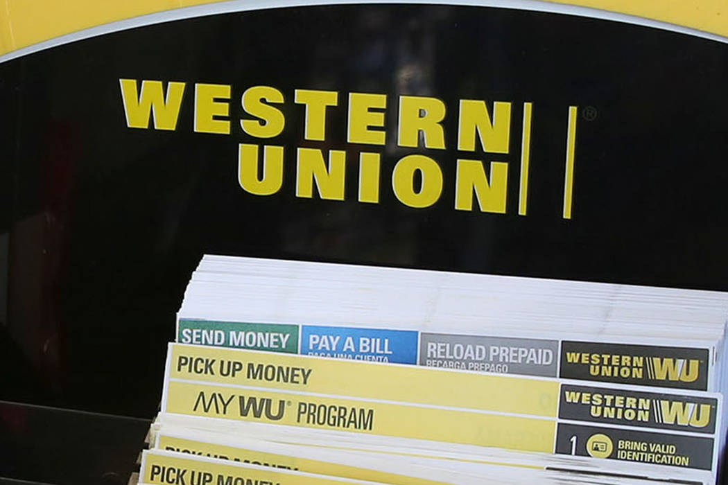 Western Union's money transfer forms are displayed as store owner Hamid Maghamfar helps his customer at Food Mart on 329 Las Vegas Blvd., on Friday, Sept. 22, 2017, in Las Vegas. Bizuayehu Tesfaye ...