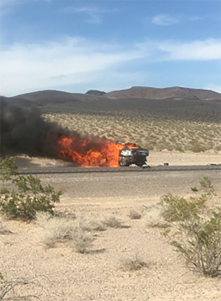 A vehicle is engulfed in flames in the multi-fatality crash on U.S. Highway 95, near Amargosa Valley in Nye County, Sunday, May 20, 2018. (Nevada Highway Patrol)