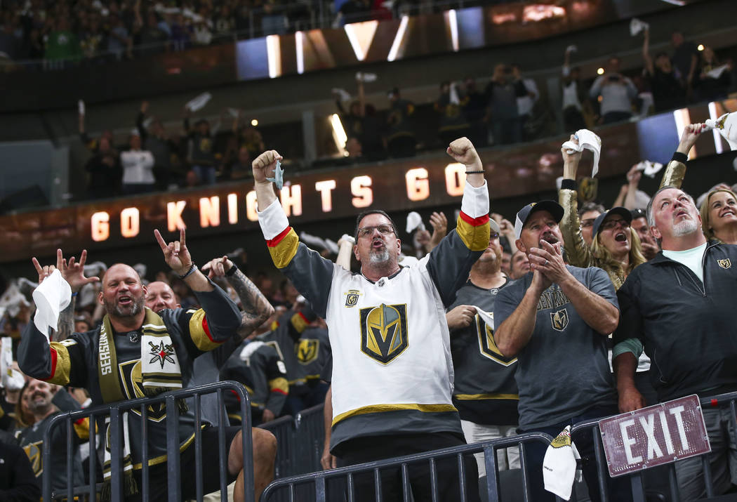 Golden Knights fans celebrate a goal by Erik Haula, not pictured, during the second period of Game 5 of an NHL hockey second-round playoff series against the San Jose Sharks at T-Mobile Arena in L ...