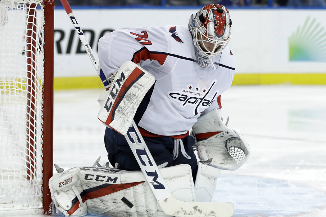 Washington Capitals goaltender Braden Holtby blocks a shot by the Tampa Bay Lightning during the second period of Game 7 of the NHL Eastern Conference finals hockey playoff series Wednesday, May 2 ...