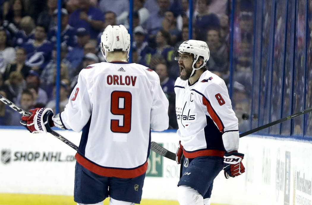 Washington Capitals left wing Alex Ovechkin (8) celebrates his goal against the Tampa Bay Lightning with teammate defenseman Dmitry Orlov (9) during the first period of Game 7 of the NHL Eastern C ...