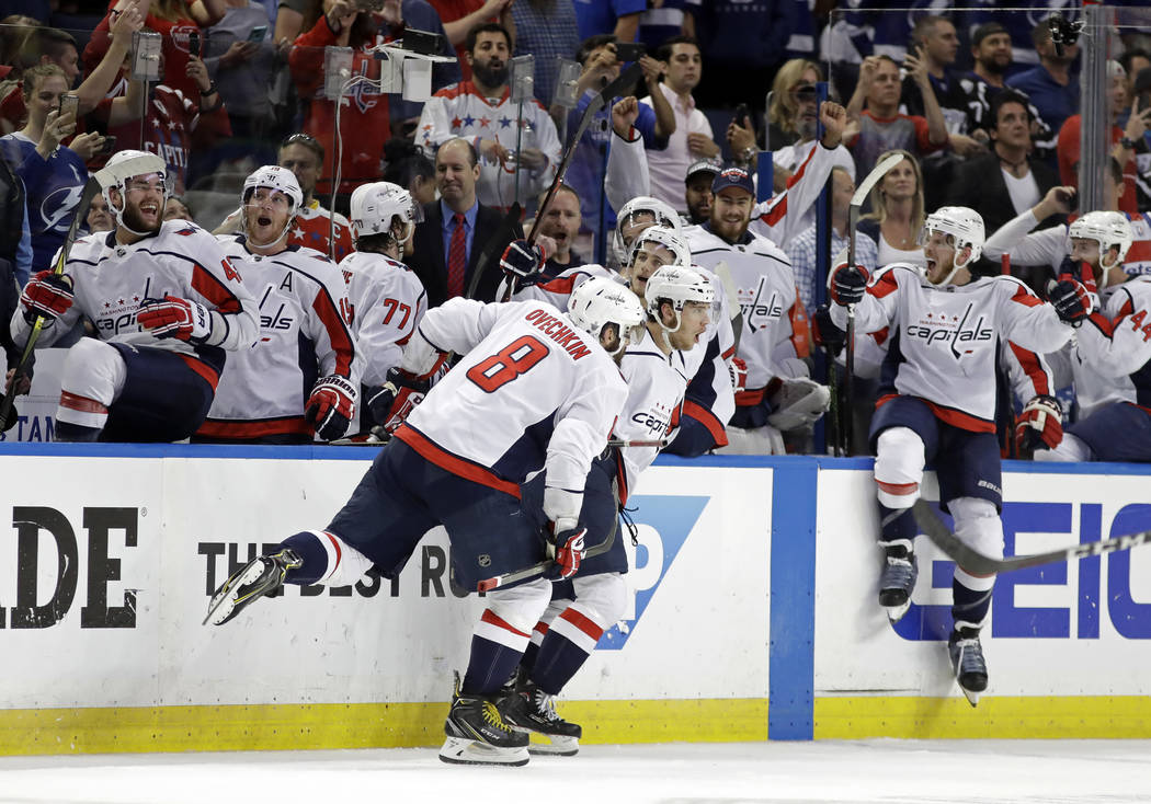 Washington Capitals, including left wing Alex Ovechkin (8). celebrate after defeating the Tampa Bay Lightning in Game 7 of the NHL Eastern Conference finals hockey playoff series Wednesday, May 23 ...