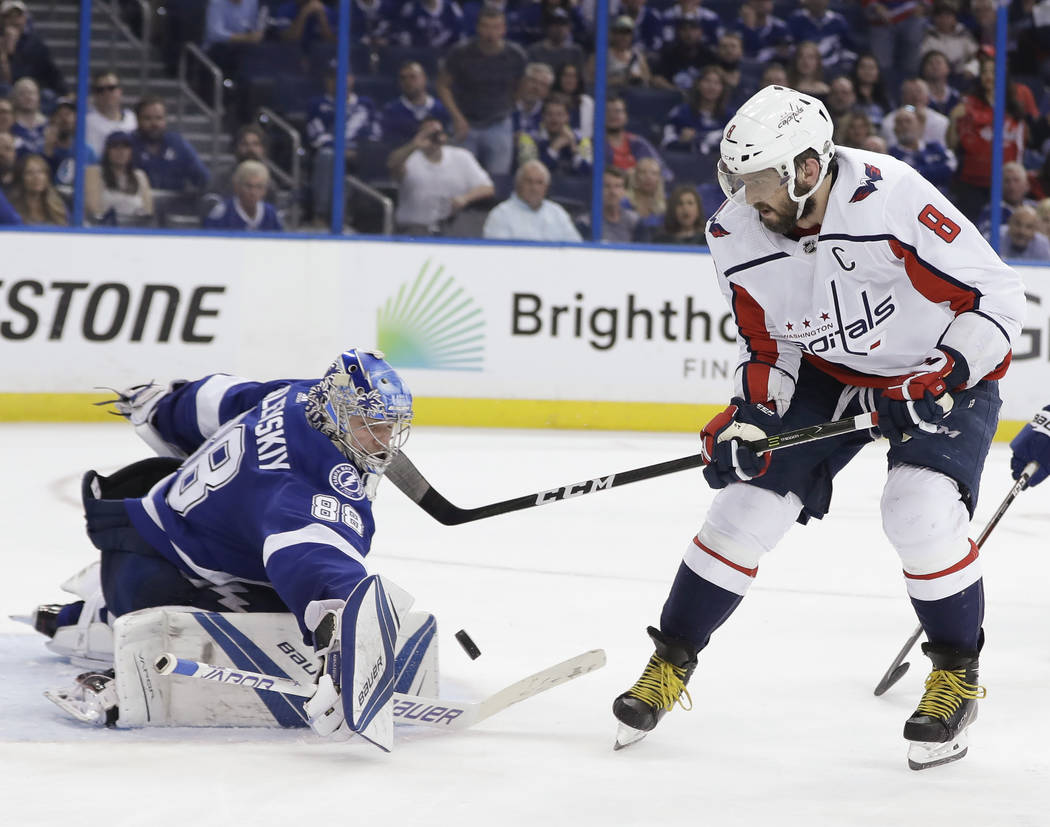 Tampa Bay Lightning goaltender Andrei Vasilevskiy (88) blocks a shot attempt by Washington Capitals' Alex Ovechkin (8) during the third period of Game 7 of the NHL Eastern Conference finals hockey ...