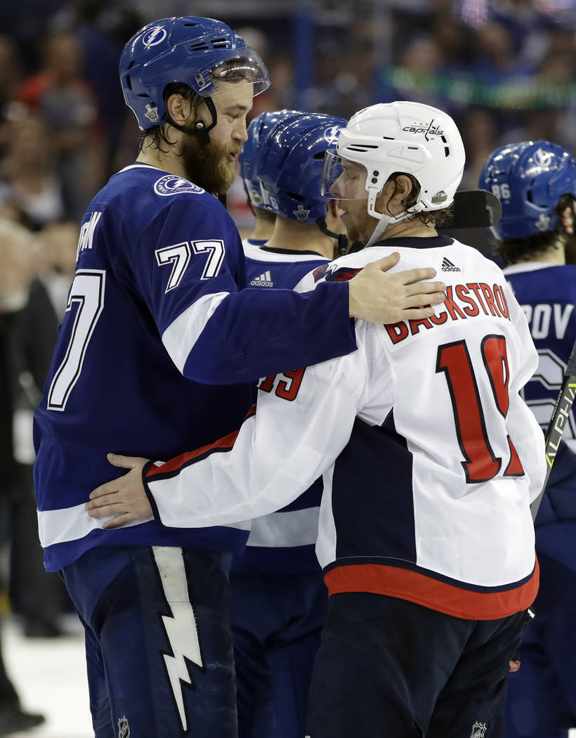 Tampa Bay Lightning defenseman Victor Hedman (77) congratulates Washington Capitals center Nicklas Backstrom (19) after the Capitals defeated the Lightning 4-0 during Game 7 of the NHL Eastern Con ...