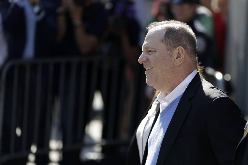 Harvey Weinstein leaves the first precinct of the New York City Police Department after turning himself to authorities following allegations of sexual misconduct, Friday, May 25, 2018, in New York ...