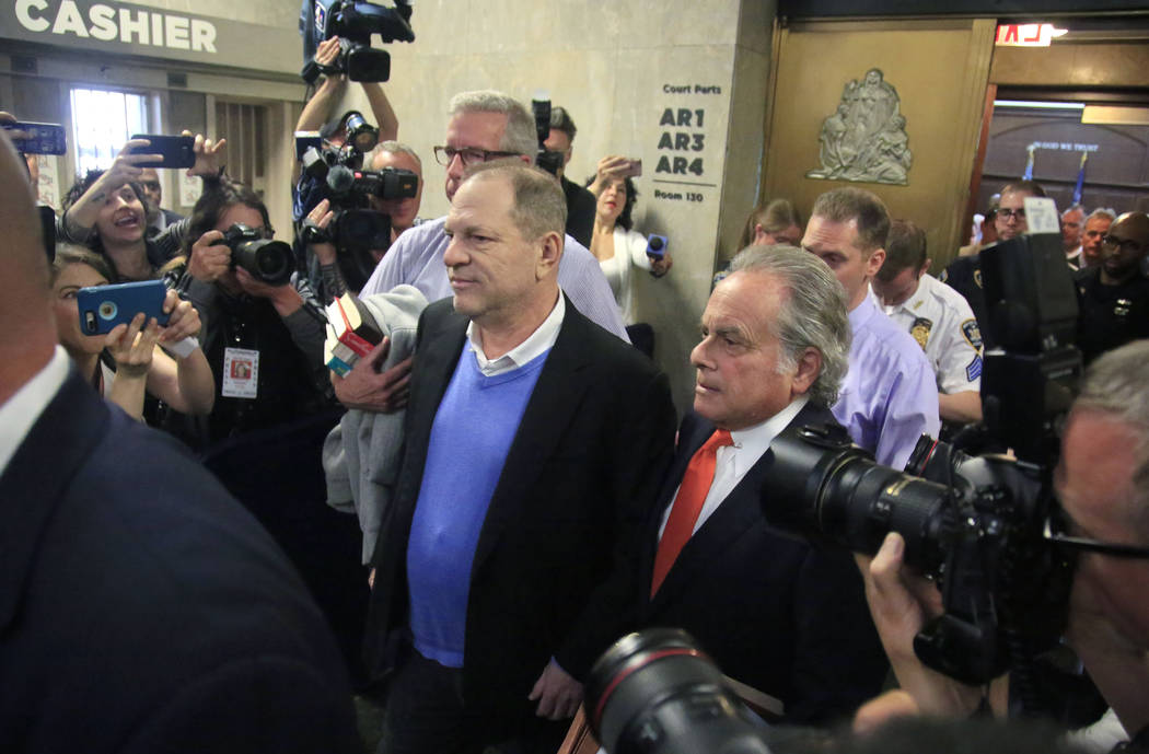 Harvey Weinstein, center, leaves with his lawyer Benjamin Brafman, right, after posting bail at Manhattan's Criminal Court, Friday, May 25, 2018, in New York. Weinstein was arraigned Friday on rap ...