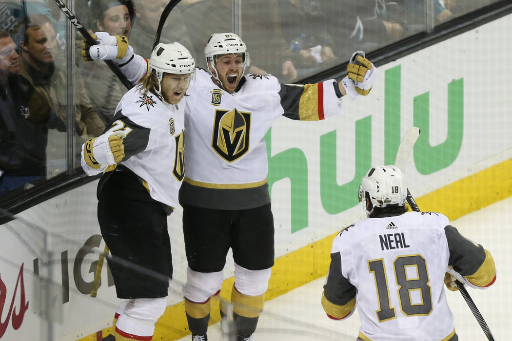 Vegas Golden Knights center William Karlsson (71) celebrates his score with center Jonathan Marchessault (81) and left wing James Neal (18) during overtime in Game 3 of an NHL hockey second-round ...