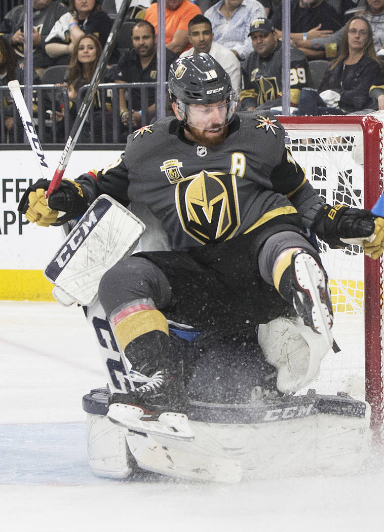 Golden Knights left wing James Neal (18) collides with Jets goaltender Connor Hellebuyck (37) in the third period during game four of Winnipeg's NHL Western Conference Finals matchup with the Gold ...