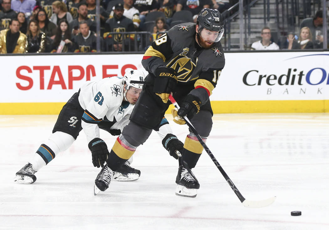 Golden Knights left wing James Neal (18) moves the puck in front of San Jose Sharks defenseman Justin Braun (61) during the third period of Game 5 of an NHL hockey second-round playoff series at T ...
