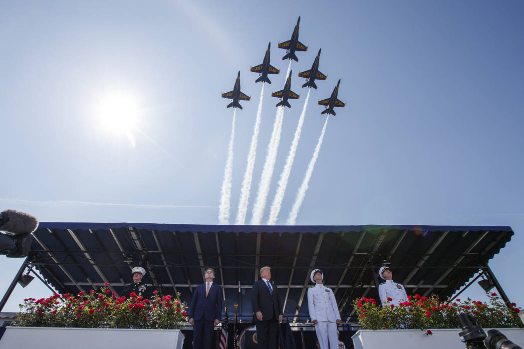 President Donald Trump looks on as the Blue Angels fly over the graduation ceremony at the U.S. Naval Academy, Friday, May 25, 2018, in Annapolis, Md. (AP Photo/Evan Vucci)