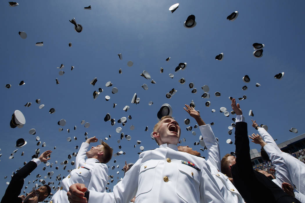 Midshipman throw their covers into the air during a graduation and commissioning ceremony with President Donald Trump at the U.S. Naval Academy, Friday, May 25, 2018, in Annapolis, Md. (AP Photo/E ...