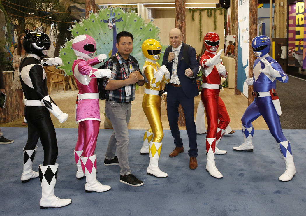 Expogoers, including Tom Fallenstein, third right, pose for photo with the iconic Mighty Morphin Power Rangers strike at the 2018 Licensing Expo on Tuesday, May 22, 2018, in Las Verges. Bizuayehu ...