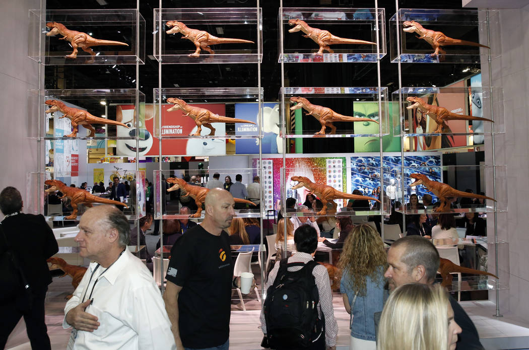 Expogoers walk past a display of dinosaurs at the 2018 Licensing Expo on Tuesday, May 22, 2018, in Las Verges. Bizuayehu Tesfaye/Las Vegas Review-Journal @bizutesfaye
