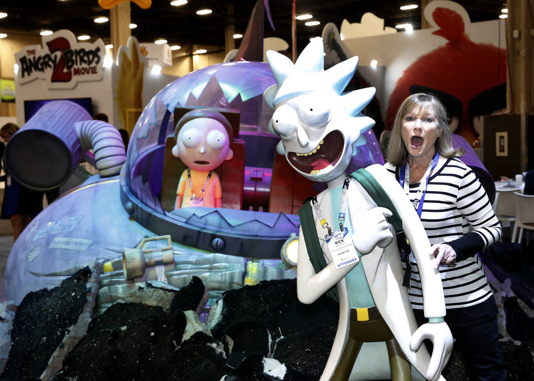 Jane Ashley poses for photo with Rick and Morty character, an American adult animated science fiction adventure comedy series, at the 2018 Licensing Expo on Tuesday, May 22, 2018, in Las Verges. B ...
