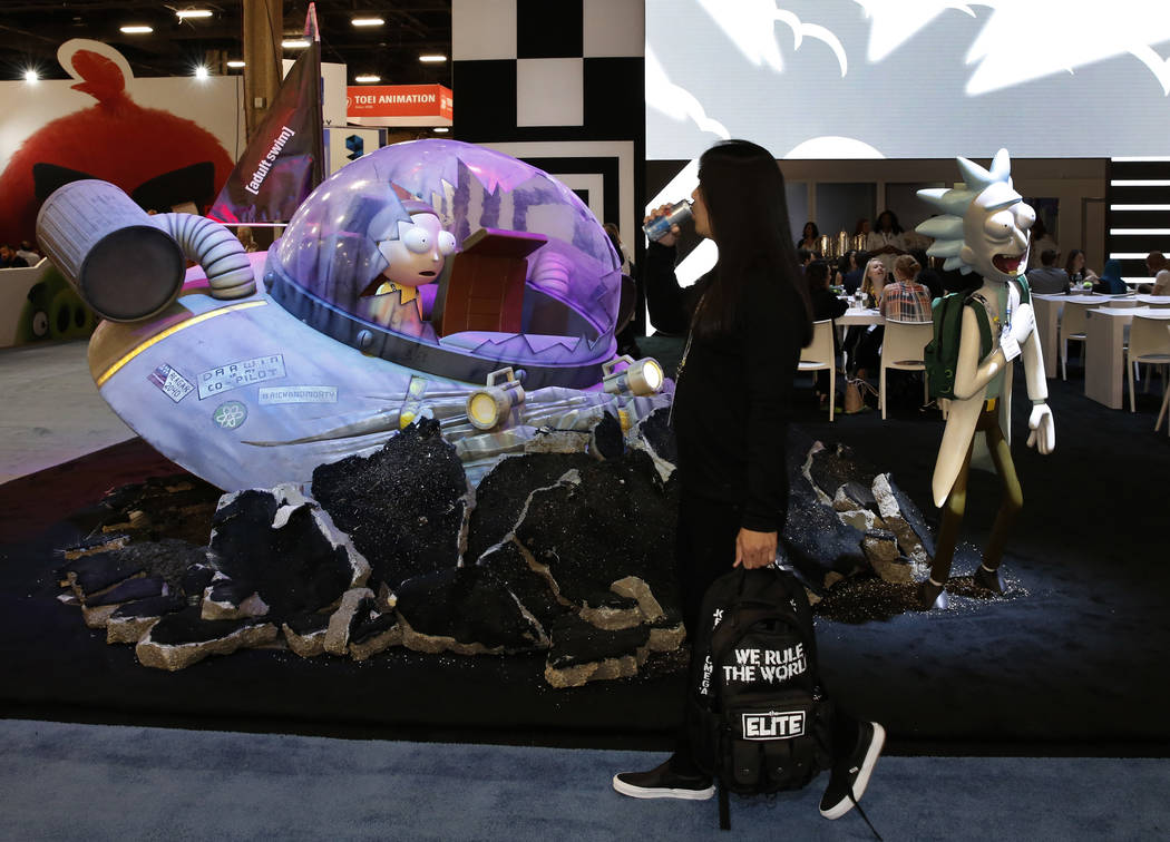 An expogoer walks past Rick and Morty character, an American adult animated science fiction adventure comedy series, at the 2018 Licensing Expo on Tuesday, May 22, 2018, in Las Verges. Bizuayehu T ...