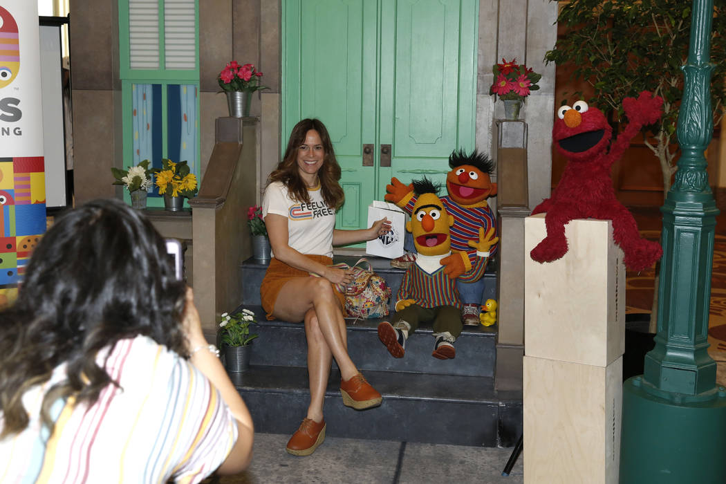 An expogoer, who declined to give her name, poses for a photo with Sesame Street characters at the 2018 Licensing Expo on Tuesday, May 22, 2018, in Las Verges. Bizuayehu Tesfaye/Las Vegas Review-J ...