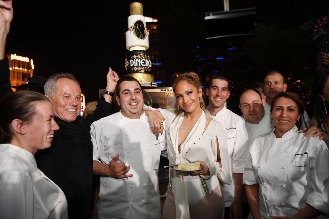 Jennifer Lopez celebrates release of new single 'Dinero' with Wolfgang Puck during sneak peek of new Spago at Bellagio on May 20, 2018 in Las Vegas, Nevada. (Photo by Denise Truscello/Getty Imag ...