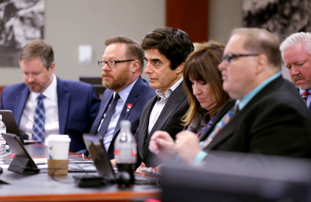 David Copperfield, center, listens to closing arguments during a civil trial at the Regional Justice Center in Las Vegas on Friday, May 25, 2018. With Copperfield are, from left, attorney Howard R ...