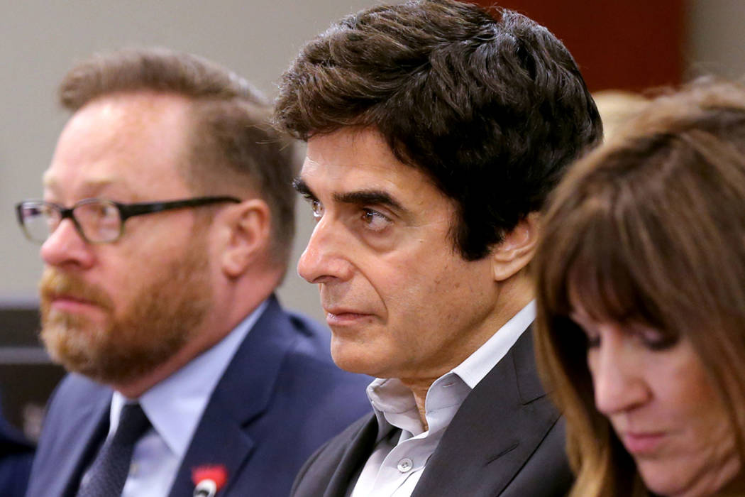 David Copperfield, center, listens to closing arguments during a civil trial at the Regional Justice Center in Las Vegas on Friday, May 25, 2018. With Copperfield are, from left, Chris Kenner, pre ...
