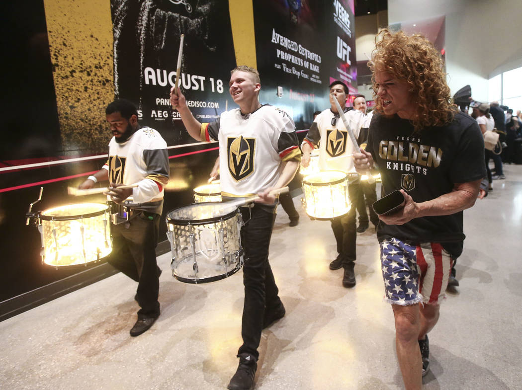 Carrot Top, right, joins the Knight Line during a pregame parade ahead of Game 1 of the NHL hockey Stanley Cup Final at the T-Mobile Arena in Las Vegas on Monday, May 28, 2018. Chase Stevens Las V ...