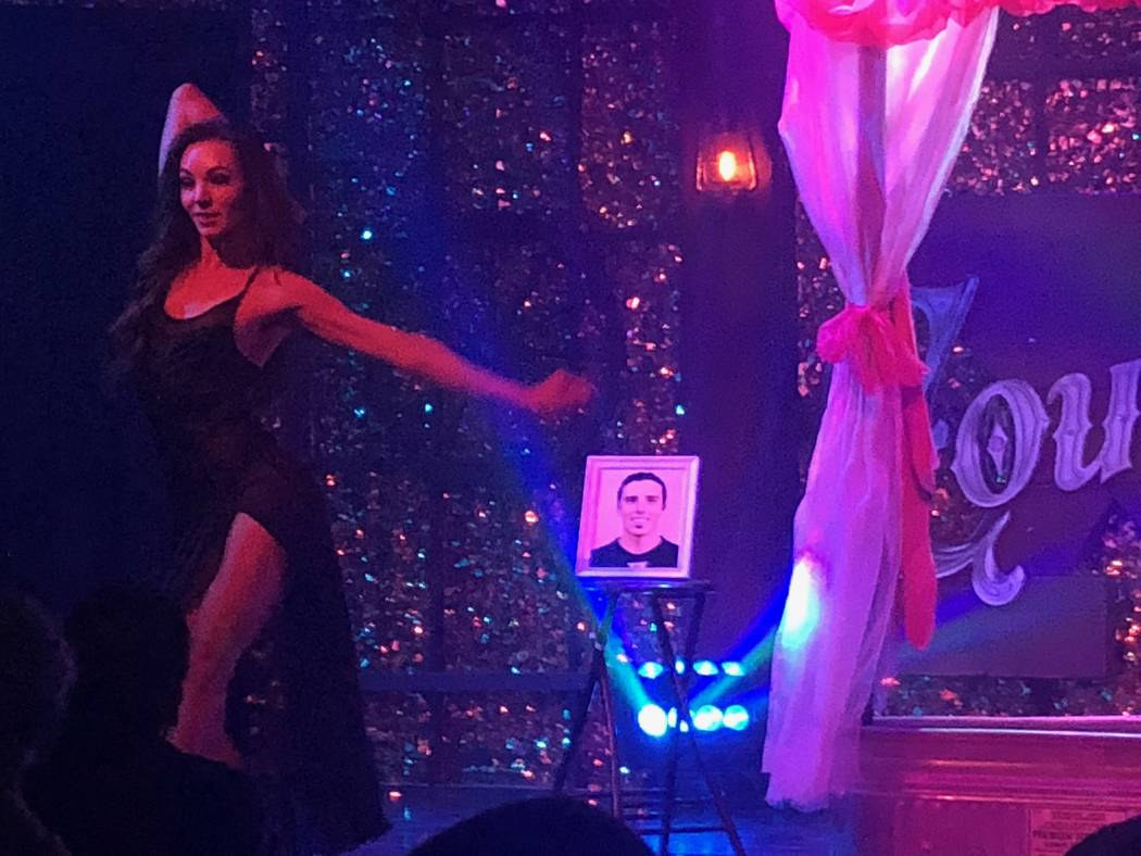 """JoLae Brandt of """"X Country"""" at Harrah's dances as a photo of Vegas Golden Knights goalie Marc-Andre Fleury is shown in the background. (Stabile Productions)"""