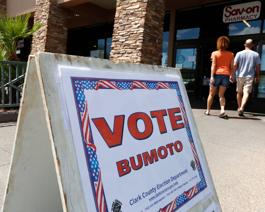 A sign is seen in front of Albertsons, at 10250 W. Charleston Blvd., where is one of the polling stations, on the first day of early voting in the Clark County elections in Las Vegas, Saturday, M ...