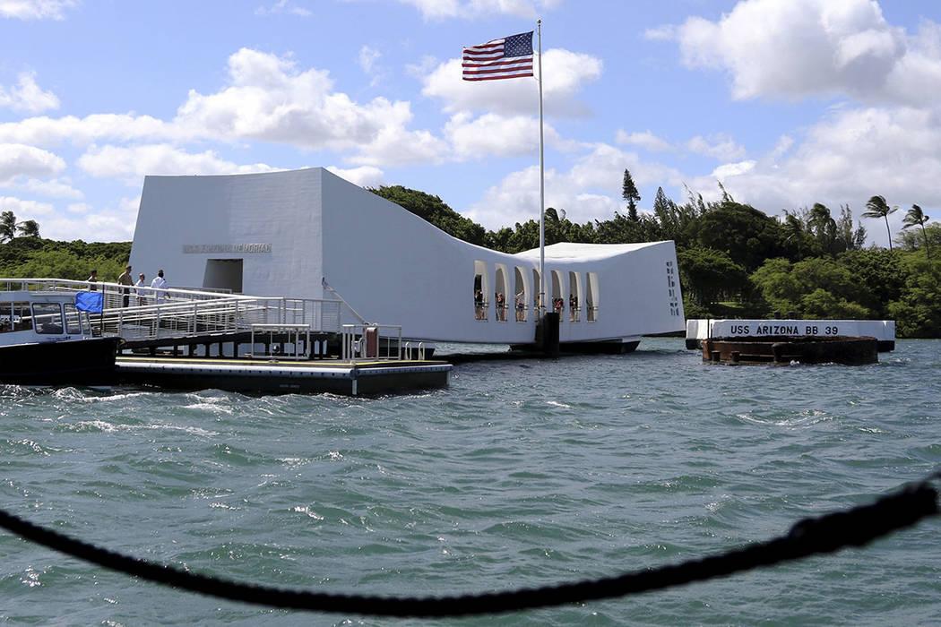 The USS Arizona Memorial is seen in Pearl Harbor, Hawaii. (AP Photo/Caleb Jones)