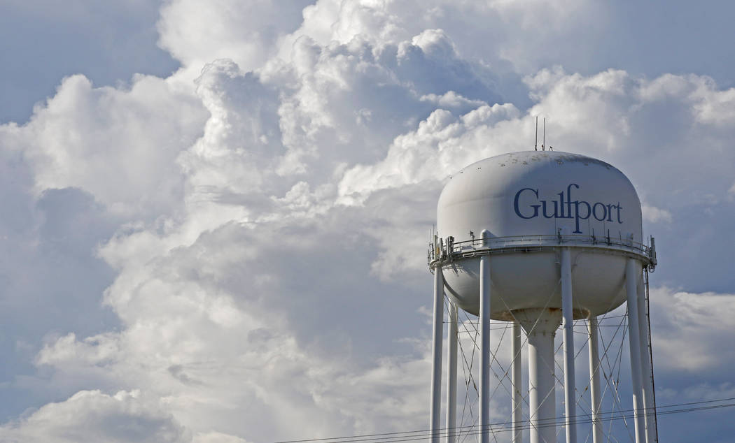 Large cloud formations gather behind the downtown Gulfport, Miss., water tower Saturday afternoon, May 26, 2018, as Subtropical Storm Alberto slowly makes its way through the Gulf of Mexico. (AP P ...