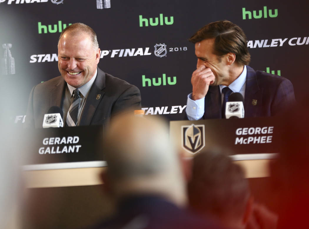 Golden Knights head coach Gerard Gallant, left, and George McPhee, general manager of the team, share a laugh during NHL hockey media day for the Stanley Cup Final at the T-Mobile Arena in Las Veg ...