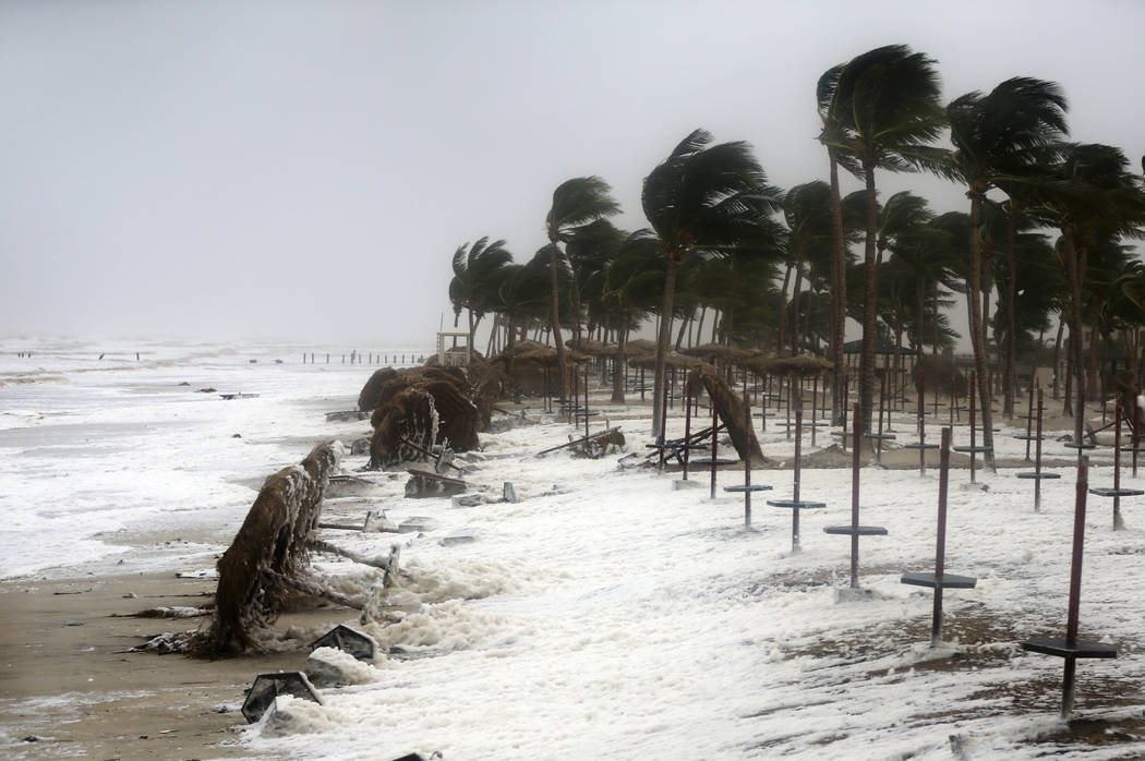 Debris and sea foam litters a beach after Cyclone Mekunu in Salalah, Oman, Saturday, May 26, 2018. Cyclone Mekunu blew into the Arabian Peninsula on Saturday, drenching arid Oman and Yemen with ra ...