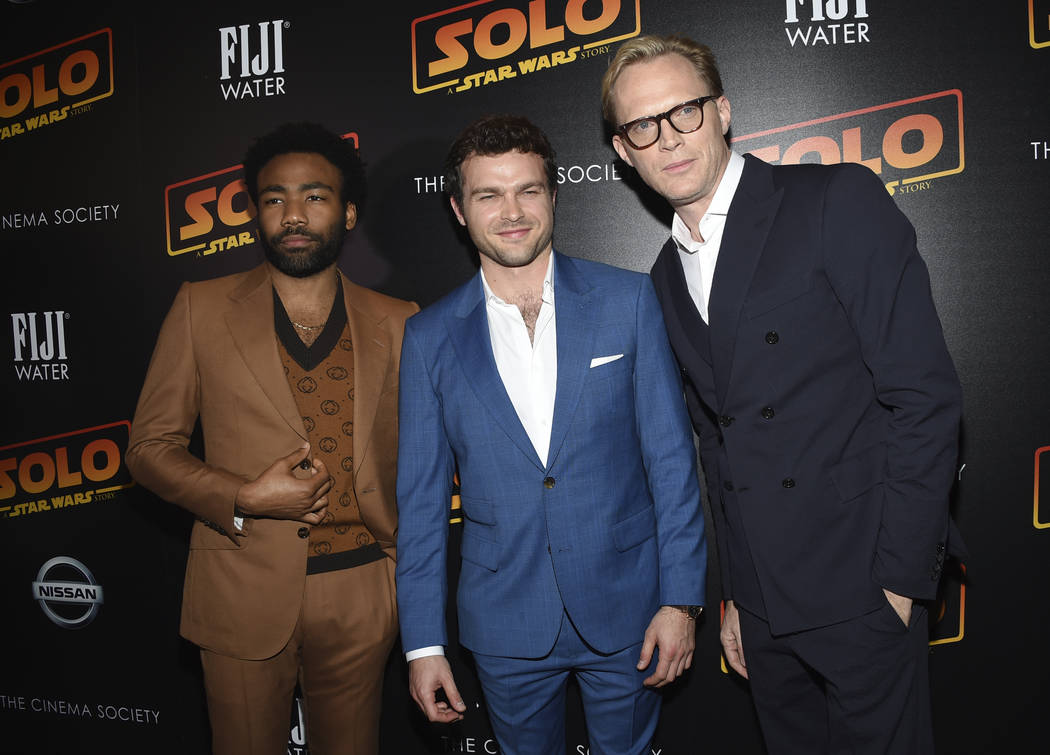 """Donald Glover, from left, Alden Ehrenreich and Paul Bettany attend a special screening of """"Solo: A Star Wars Story"""" at SVA Theatre on Monday, May 21, 2018, in New York. (Photo by Evan Ag ..."""
