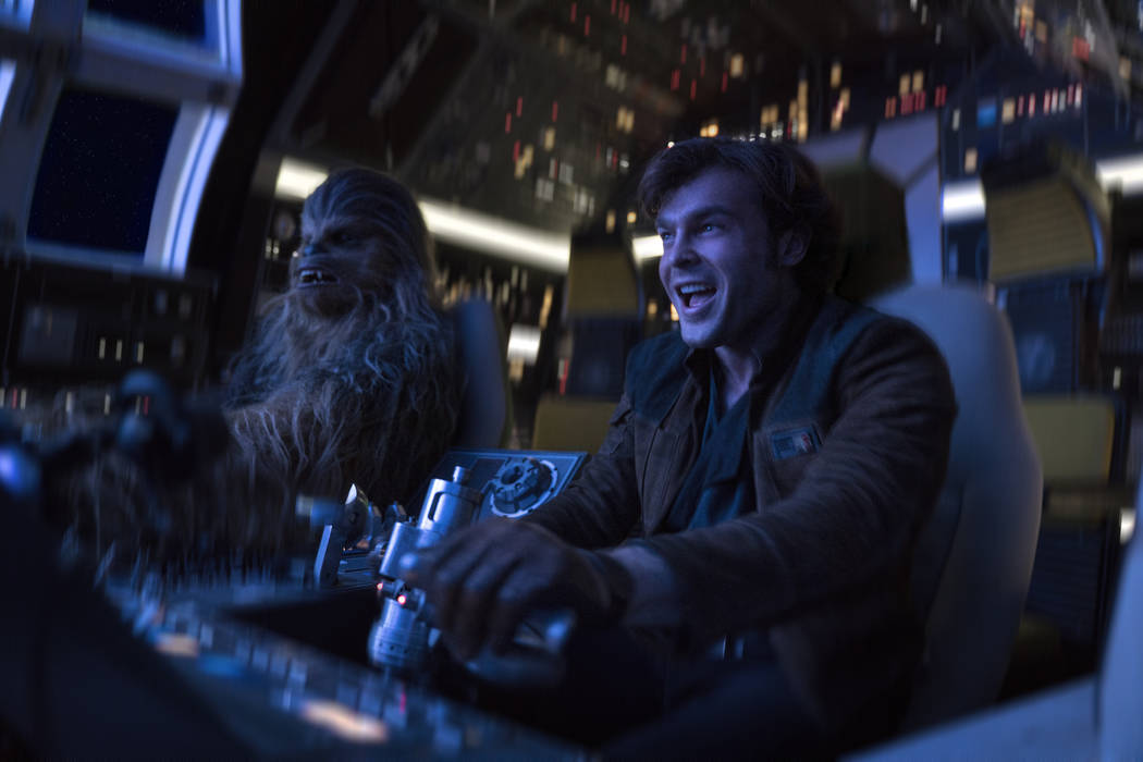 In this image released by Lucasfilm Alden Ehrenreich right and Joonas Suotamo appear in a scene from