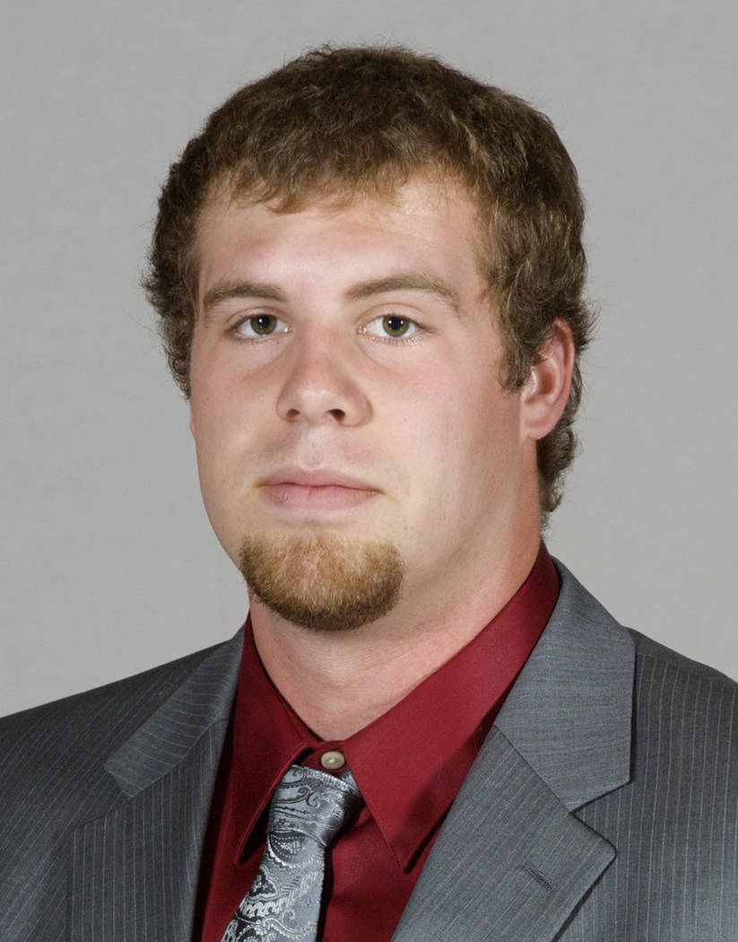 In this undated photo provided by Southern Illinois University, Jason Seaman, a defensive end for the SIU football team, poses for a photo in Carbondale, Ill. Seaman, now a science teacher at Nobl ...