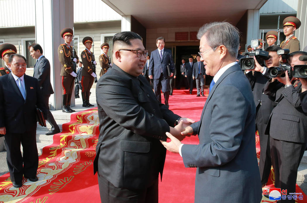 In this May 26, 2018, photo provided on May 27, 2018, by the North Korean government, North Korean leader Kim Jong Un, left, and South Korean President Moon Jae-in, right, shake hands after their ...