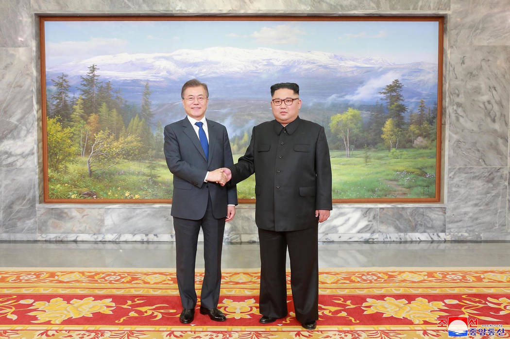 In this May 26, 2018, photo provided on May 27, 2018, by the North Korean government, North Korean leader Kim Jong Un, right, and South Korean President Moon Jae-in, left, shake hands before their ...