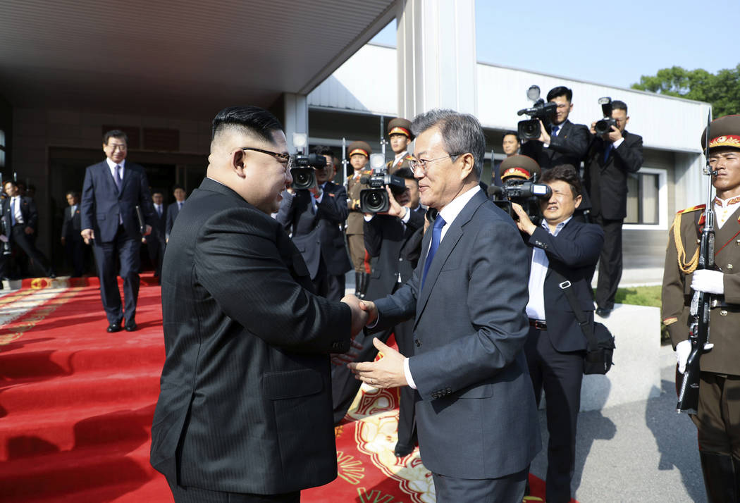 In this May 26, 2018 photo provided on May 27, 2018, by South Korea Presidential Blue House via Yonhap News Agency, North Korean leader Kim Jong Un, left, and South Korean President Moon Jae-in, ...