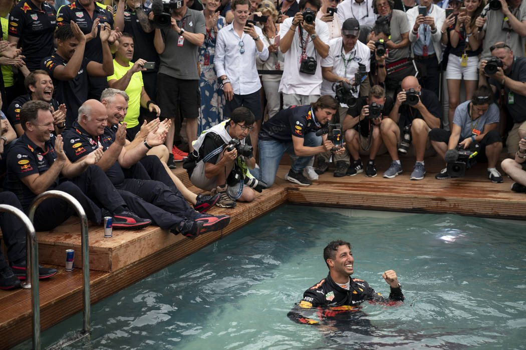 Red Bull driver Daniel Ricciardo of Australia celebrates in a pool with his team after winning the Monaco Formula One Grand Prix, at the Monaco racetrack, in Monaco, Sunday, May 27, 2018. (AP Phot ...