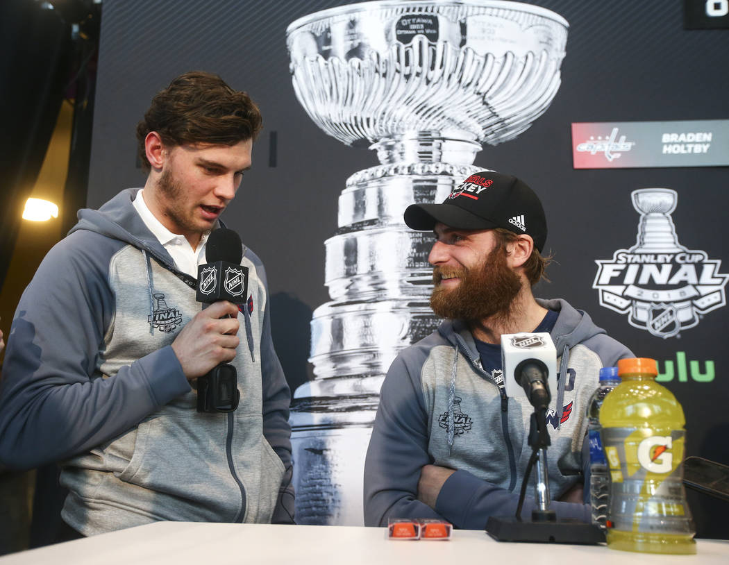 Washington Capitals left wing Andre Burakovsky, left, interviews goaltender Braden Holtby during NHL hockey media day for the Stanley Cup Final at the T-Mobile Arena in Las Vegas on Sunday, May 27 ...