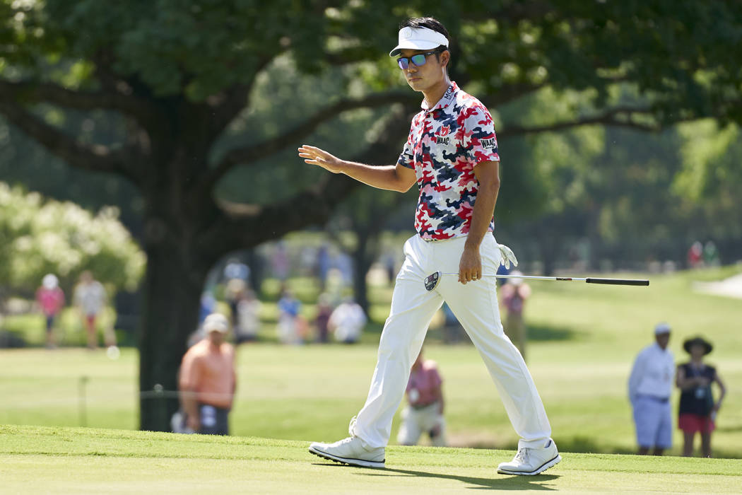 Kevan Na waves to the crowd after a shot on the second hole during the final round of the Fort Worth Invitational golf tournament at Colonial Country Club in Fort Worth, Texas, Sunday, May 27, 201 ...
