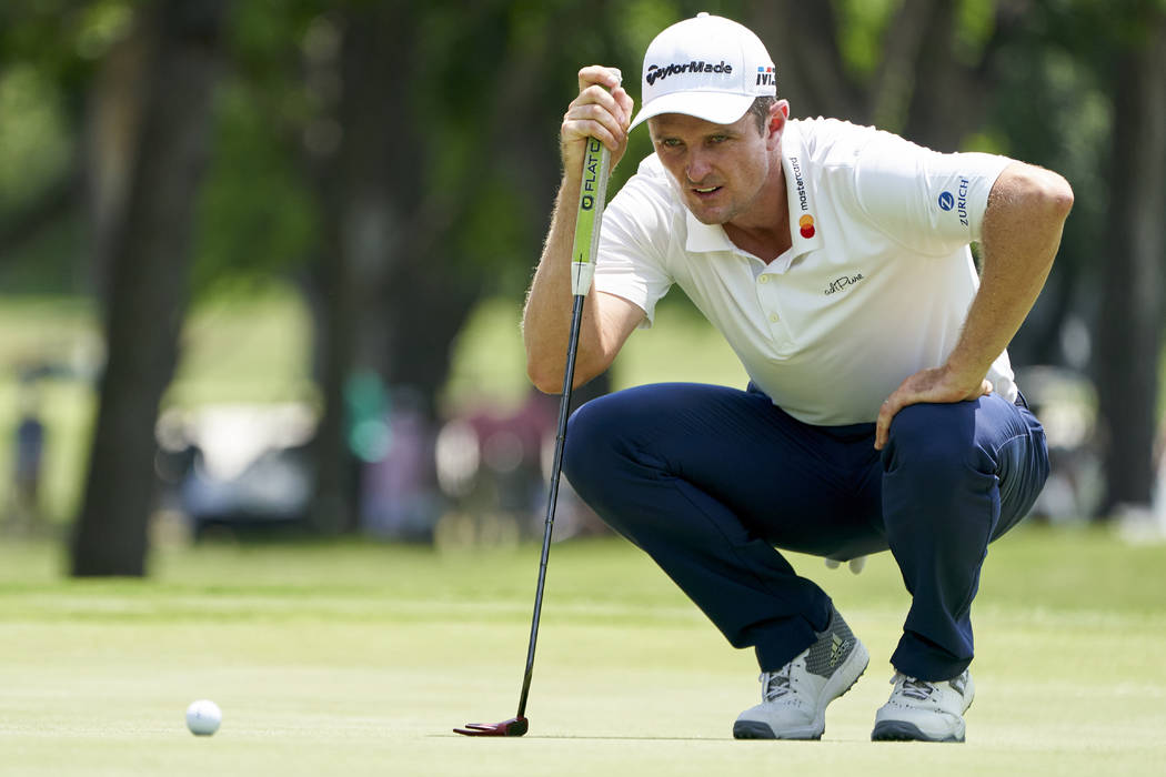 Justin Rose prepares to putt on the seventh hole during the final round of the Fort Worth Invitational golf tournament at Colonial Country Club in Fort Worth, Texas, Sunday, May 27, 2018. (AP Phot ...