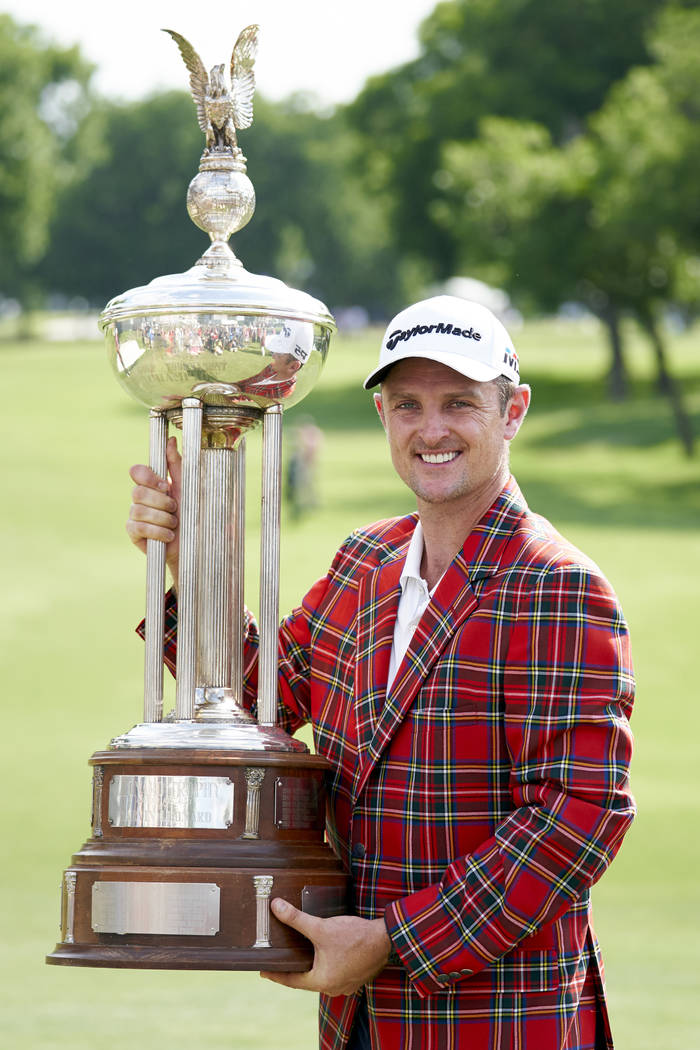 Justin Rose, of England, poses for a photo with the trophy after winning the Fort Worth Invitational golf tournament at Colonial Country Club in Fort Worth, Texas, Sunday, May 27, 2018. (AP Photo/ ...