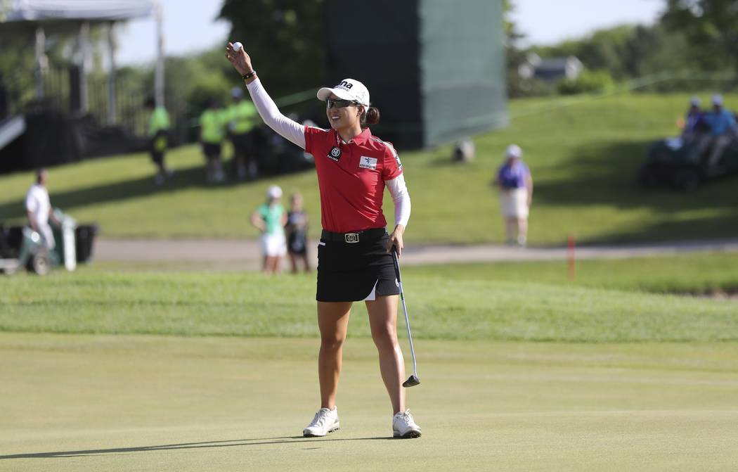 Minjee Lee of Australia waves after winning the LPGA Volvik Championship golf tournament on the final hole at the Travis Pointe Country Club Sunday, May 27, 2018, in Ann Arbor, Mich. (AP Photo/Car ...