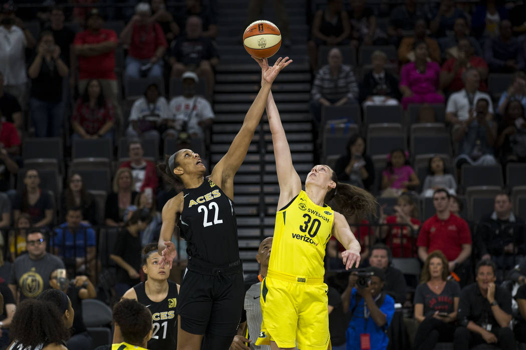 Las Vegas Aces center A'ja Wilson (22) and Seattle Storm forward Breanna Stewart (30) tip off at the start of a WNBA basketball game at the Mandalay Bay Events Center in Las Vegas on Sunday, May 2 ...