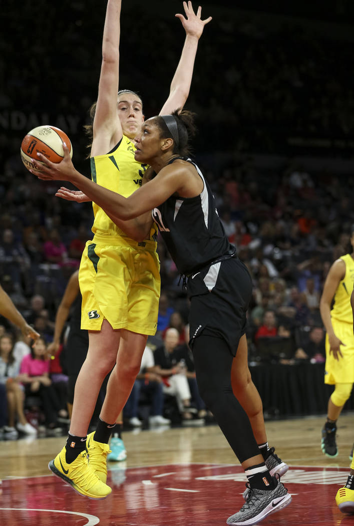 Las Vegas Aces center A'ja Wilson (22) goes up for a shot against Seattle Storm forward Breanna Stewart (30) in the second half of a WNBA basketball game at the Mandalay Bay Events Center in Las V ...